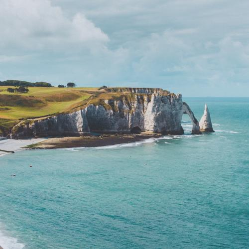 Etretat White Cliffs And Beach In Normandy